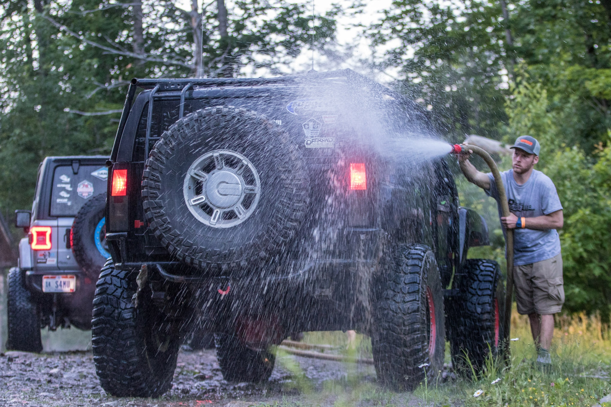 Playing in the mud isn't so bad when you know there's a car wash on the premises to get all of that sediment and debris out of your wheels, frame, and bearings. Chris Paul knows what's up. He had his co-driver, Kyle Cunliffe, do the cleaning!