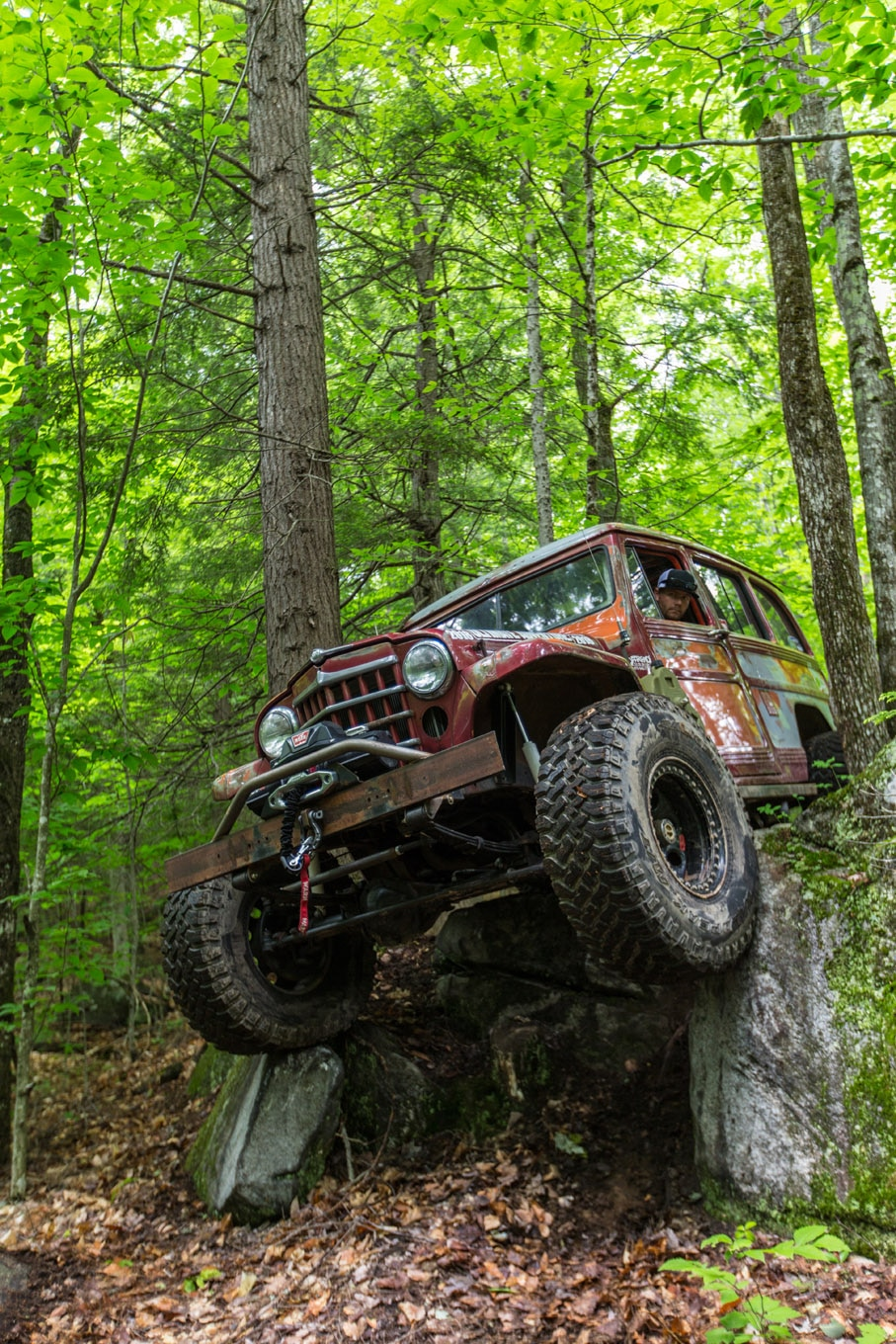 The trails in Bethel, Maine, got technical right off the bat. Despite this steep drop between two trees, Rick Prater managed to keep the body of his Willys Wagon clean on the UA. Wheelbase was your friend on this obstacle, but your enemy elsewhere on this super-tight and twisty trail that meandered over big boulders and through tight tree squeezes. It was epic!