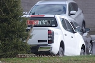 nissan navara frontier test mule right rear angle