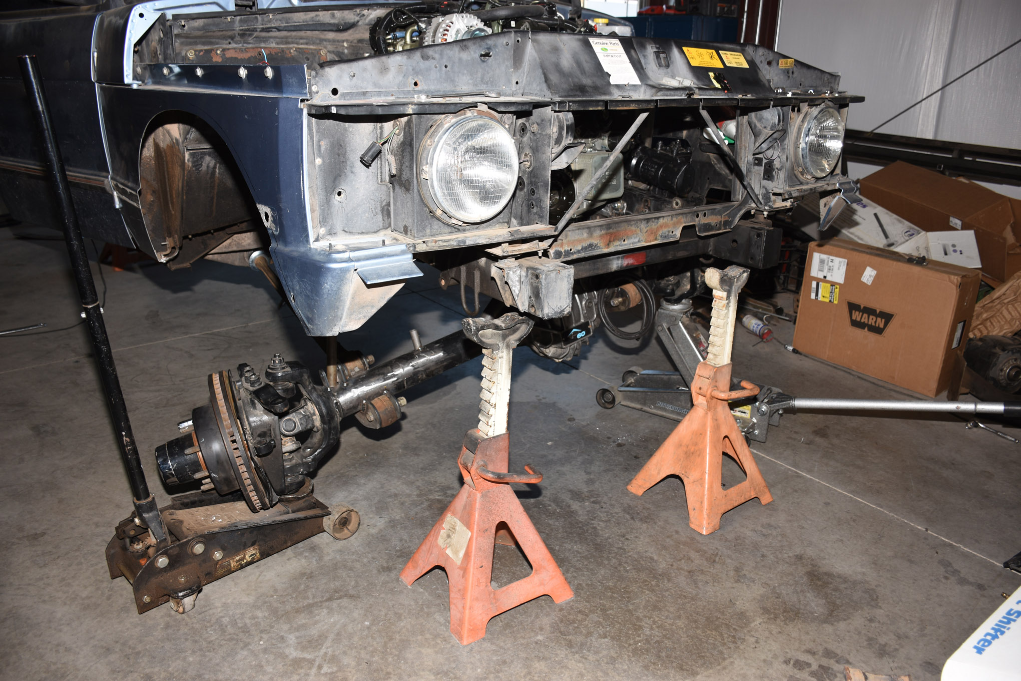With the suspension roughly built we can cycle the suspension front and rear to check for clearances and measure for the Skyjacker M95 monotube rear shocks we will run. We reused the factory Rover rear upper shock mounts and welded on lower shock mounts from RuffStuff Specialities.