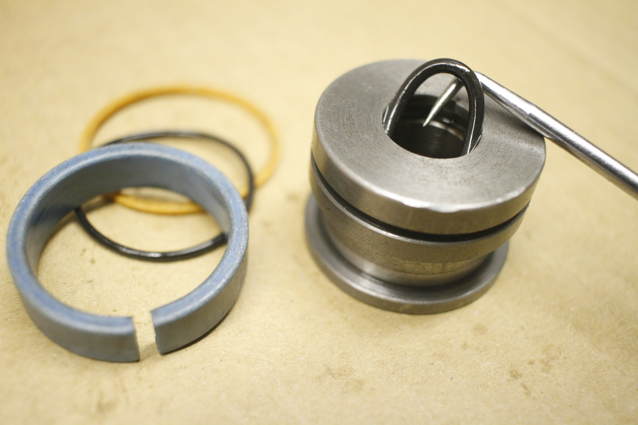There are internal and external seals, which need to be removed from the piston assembly.