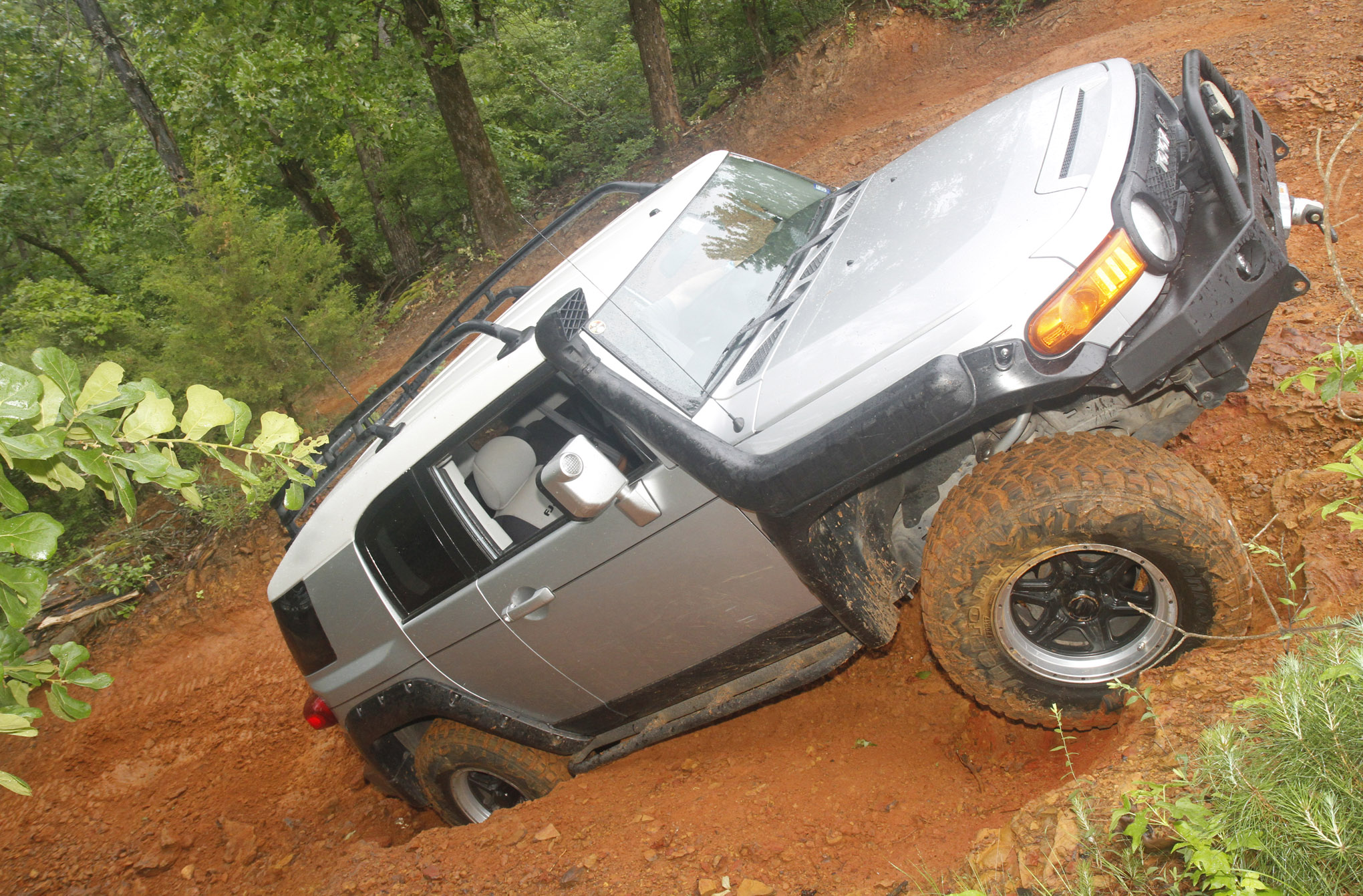 George Stanley climbs up one of the Jeep Eater trail exits. His 2008 FJ Cruiser is much more capable than stock with All-Pro Off Road A-arms, Walker Evans coilovers, 4.88 gears, and 35-inch mud-terrain tires.