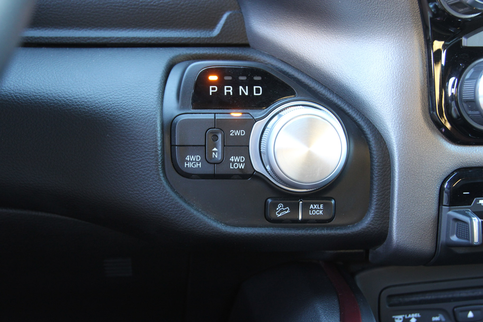 Like the GM trucks, the Ram Rebel uses buttons to select the transfer case mode, but they are on the right side of the steering wheel. Don't get us started on the rotary dial for the transmission shifter.