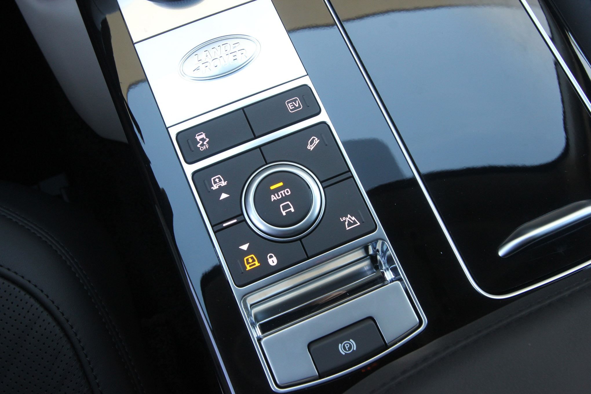 Both the Range Rover and the Range Rover Sport have fulltime 4WD and use a button to engage the low range reduction in the transfer case. It is located with all of the controls for the air suspension and hill descent, around the Terrain Response dial.