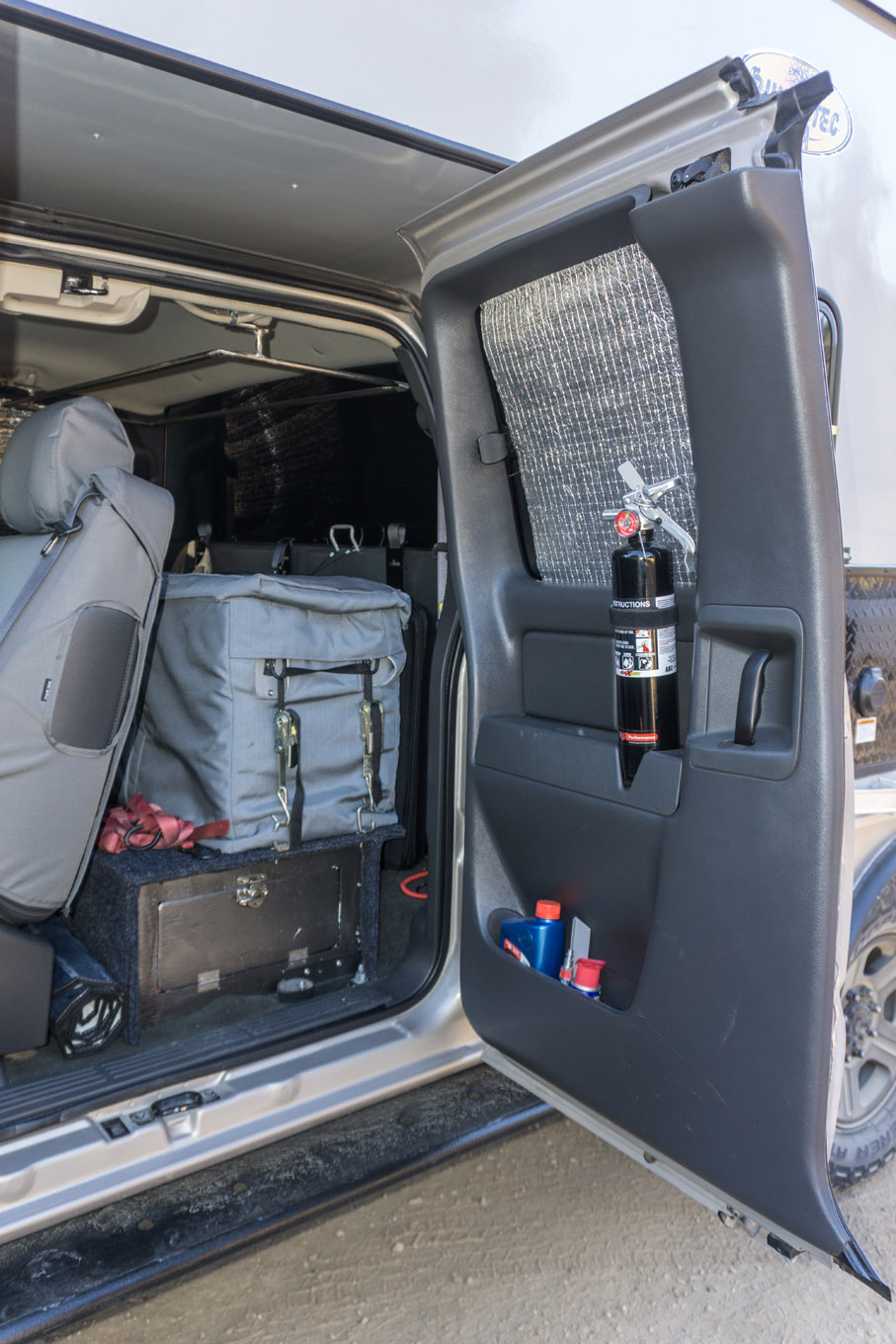 The rear seats were removed and replaced with a custom storage