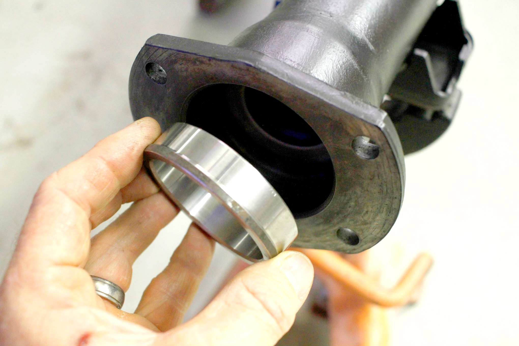 Steel bearing spacer rings included in the kit slip into the housing and seat up against each inner seal.