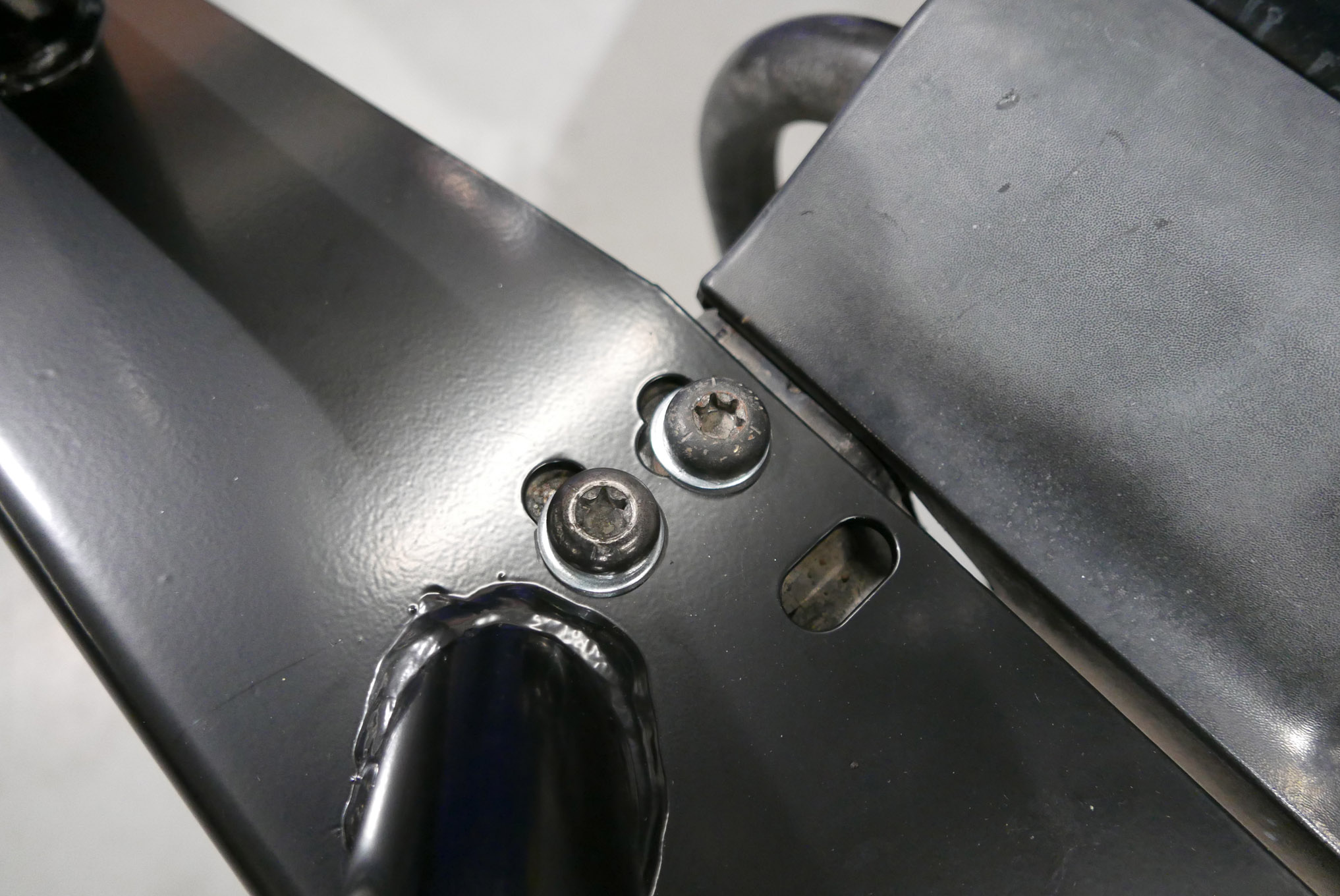 We removed the stock front bumper and saved the factory hardware for reuse. The C-channel design of the front Rampage Recovery bumper (PN 76510) made it easy to slide onto the frame horns so it could be secured up top with two of the stock Torx bolts on each end.