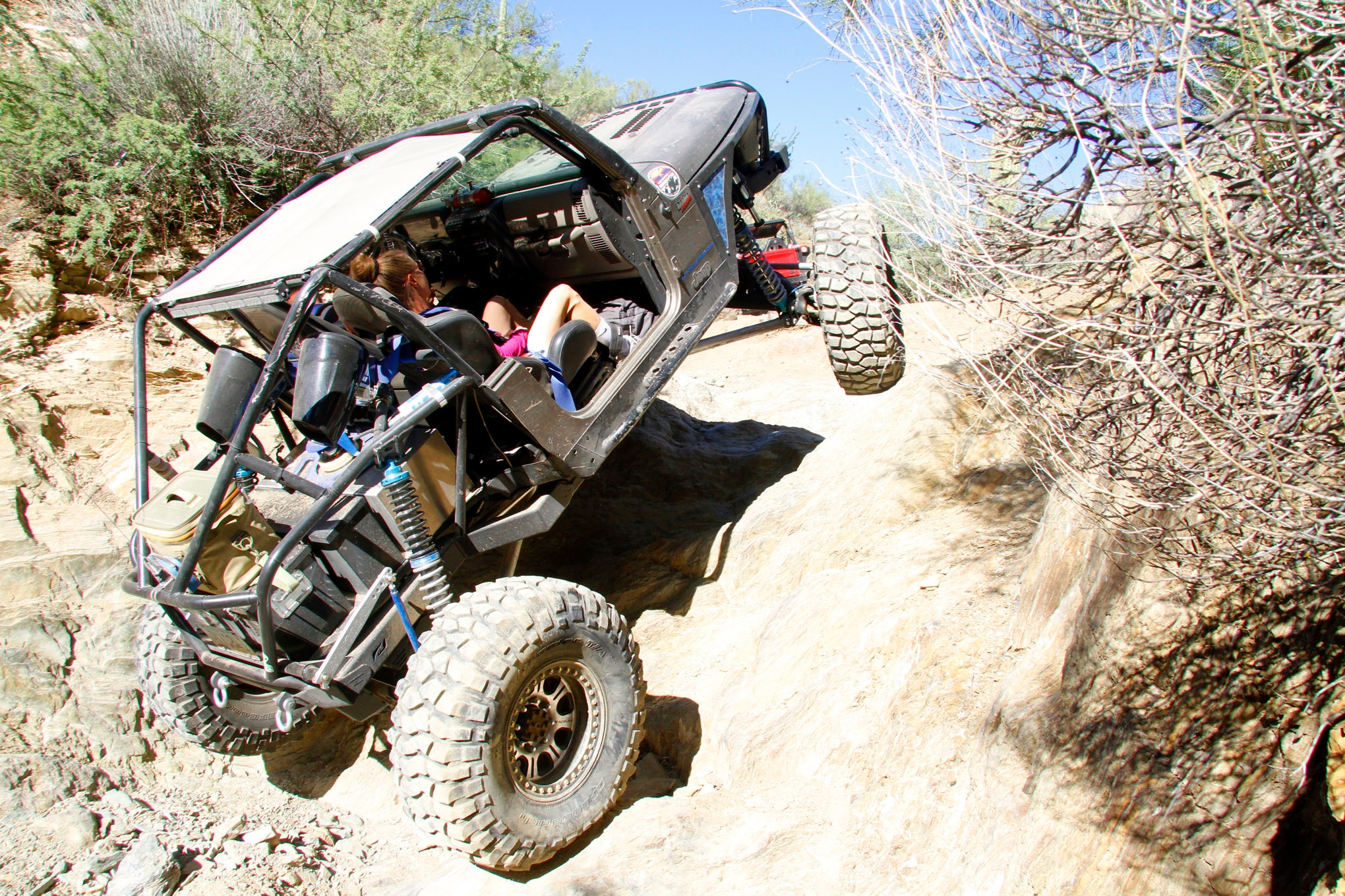 Collateral Damage was our first trail of the day. After working their way up the initial trail obstacles, Tyler and Nicole Parsons throttled up this steep waterfall in their buggied 2003 Rubicon. Lost Industries built the linked suspension on the Wrangler using 16-inch-travel King coilovers. The rear has been modified with a Motobilt back-half kit.