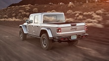 2020 Jeep Gladiator Rubicon rear side motion view down trail