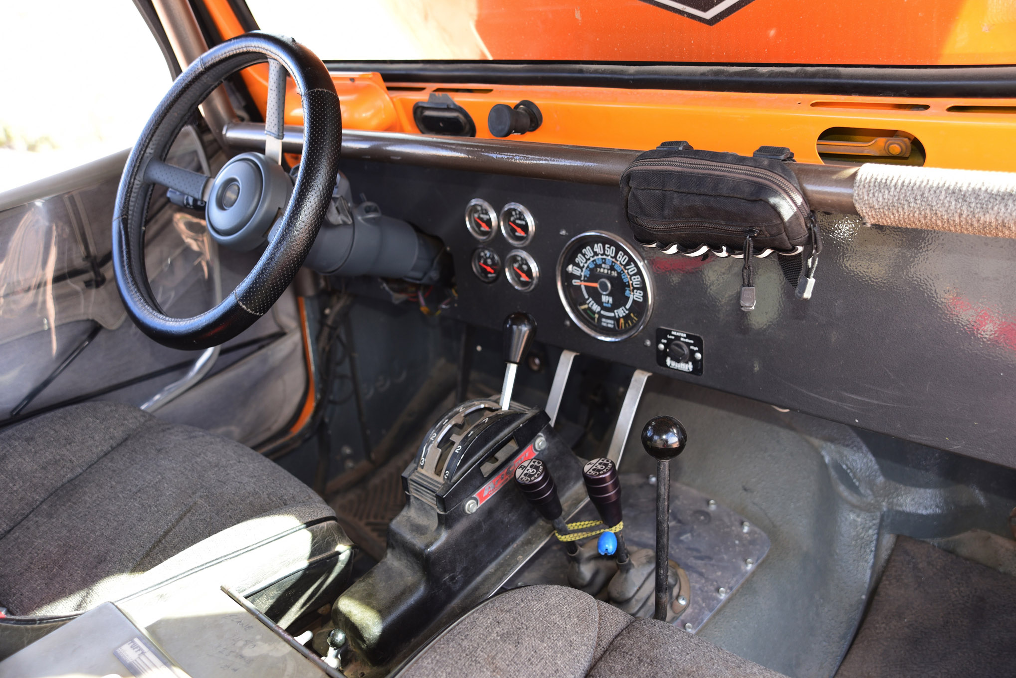 Interior appointments are minimalistic. Beard seats, a fairly bare dash, the important auxiliary gauges, a stock center-mounted speedo, an Art Carr shifter for the C4, and brake line lock switches just out of sight in front of the Tuffy center console are the highlights.