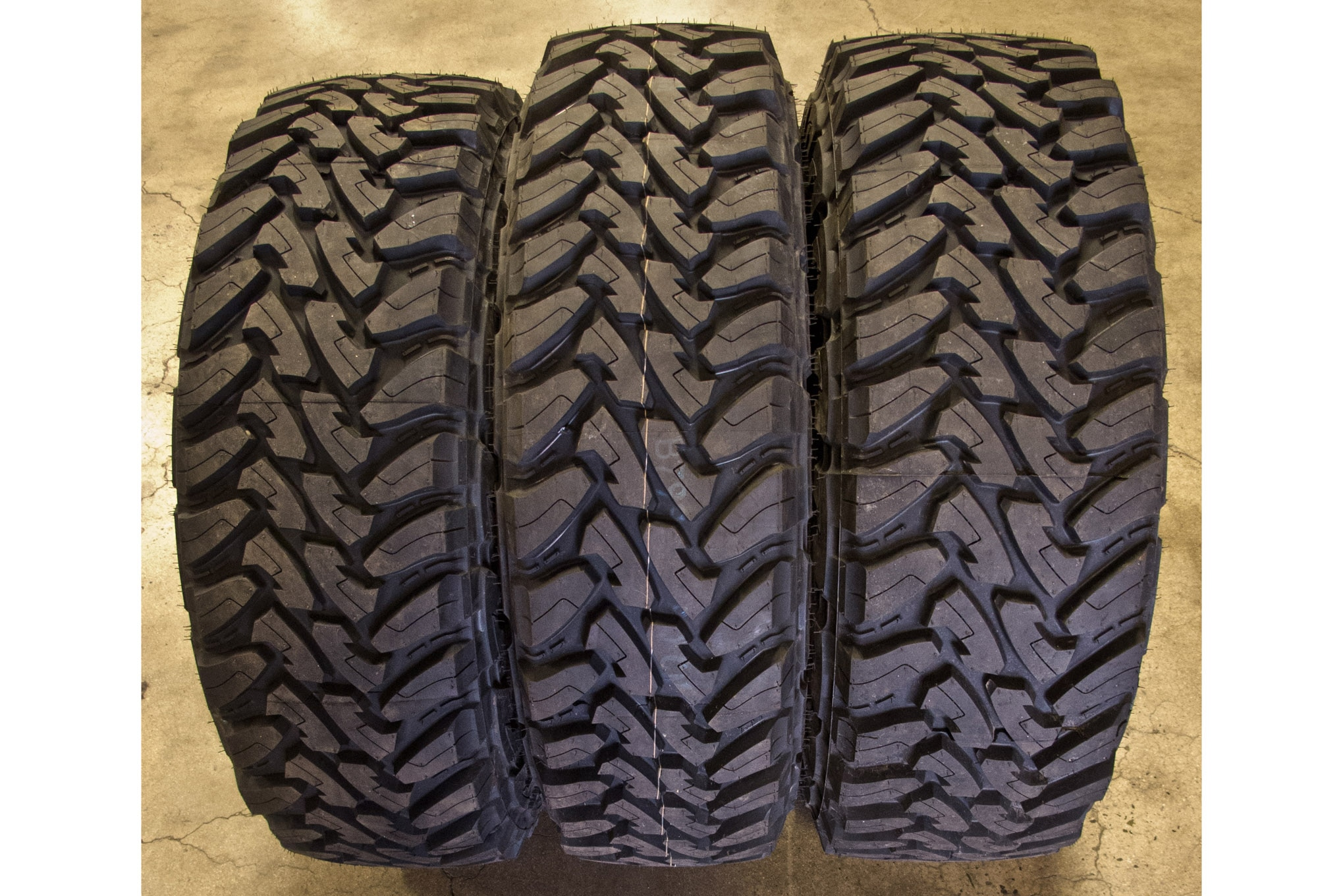 Some tires are offered in a variety of widths. For example, 255/85R16, 285/75R16, and 305/70R16 are all approximately 33 inches tall but vary in width. Toyo offers the Open Country M/T (shown) and BFGoodrich offers the Mud Terrain KM2 in all three of these sizes, so you have options.