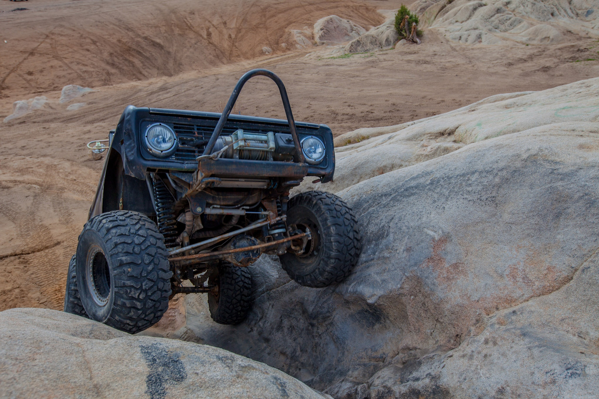 Wide tires can be useful on several different terrains, including rocks. The more the tires stick out from the body the more they keep rocks and other obstacles away. The extra rubber can also be the difference between going forward and just spinning your tires.