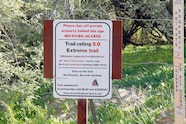 015 table mesa trails collateral damage trail sign