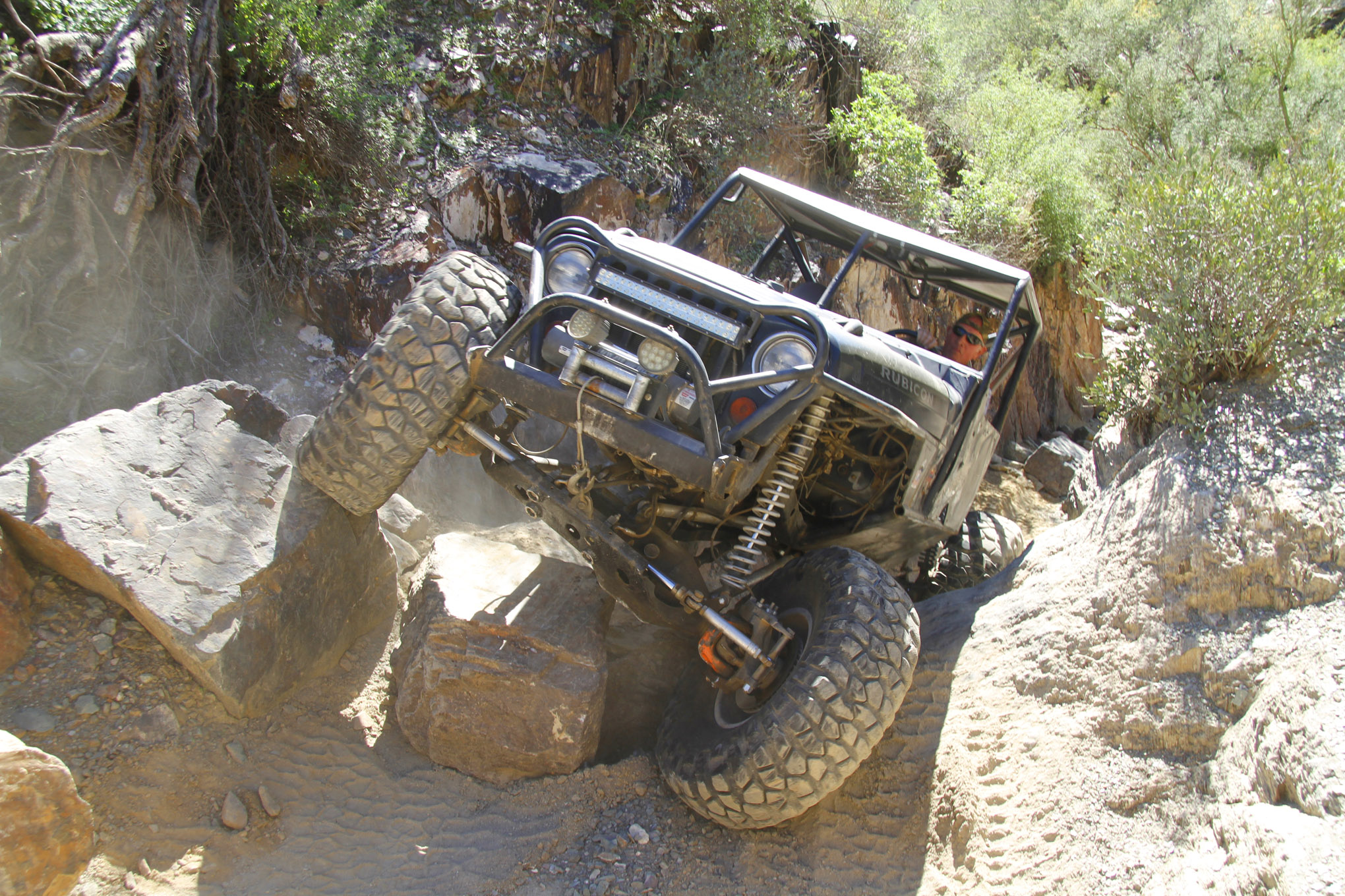 The final climb up and out of the chute on Anaconda can be tricky with this axle-grabbing boulder. Dan Felix threaded his 2006 Rubicon Unlimited up and over the rocks with the help of 39-inch BFG Red Label Krawlers on a RuffStuff 609 front axle and a GM 14-Bolt rear axle.