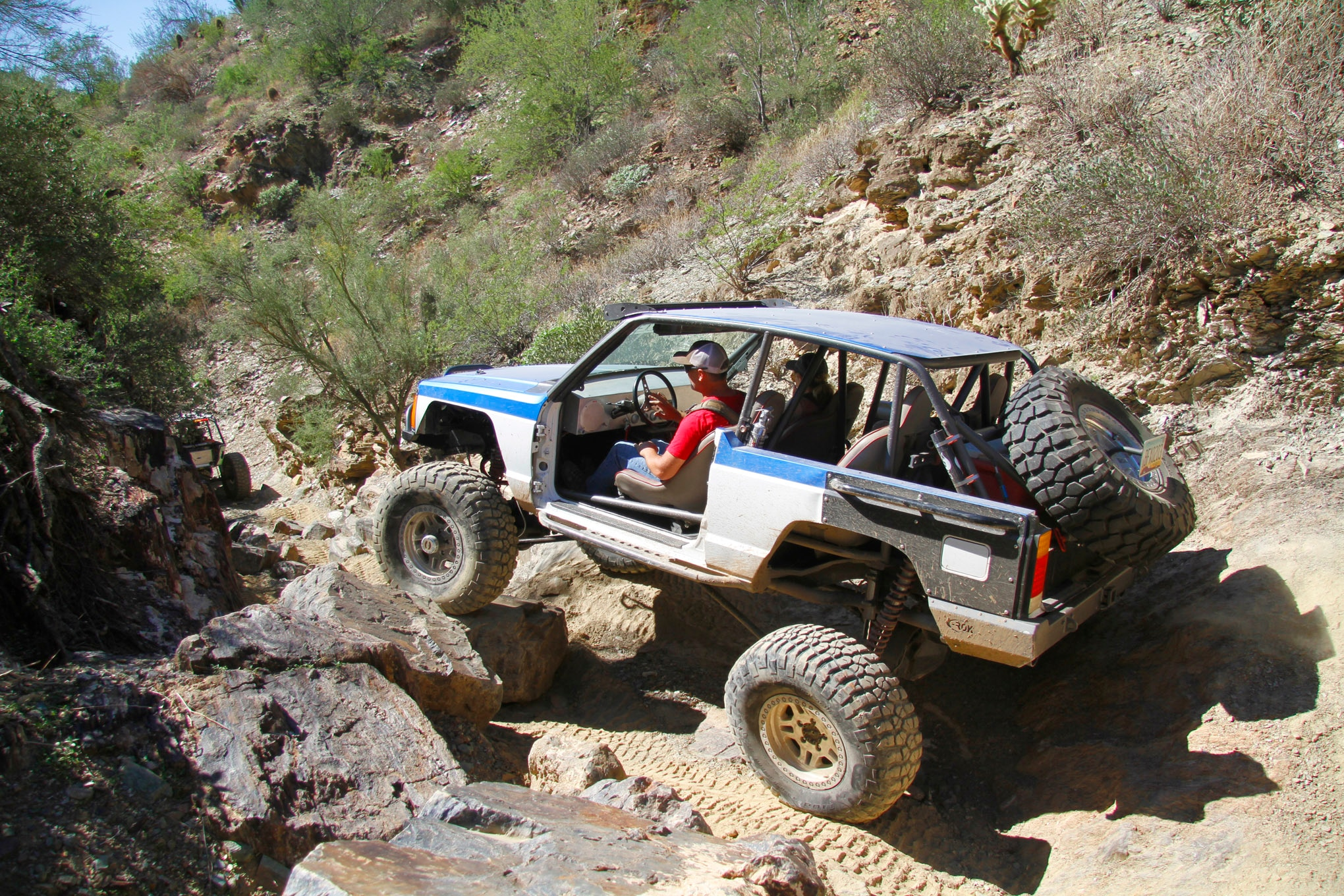 Neal Hancock had the lone Cherokee on the trail. His chop-top XJ is heavily modified though. The 6.0L GM V-8 and four-speed auto feed an Atlas transfer case. Built 1-ton axles and custom linked suspension are also part of the hardware list.