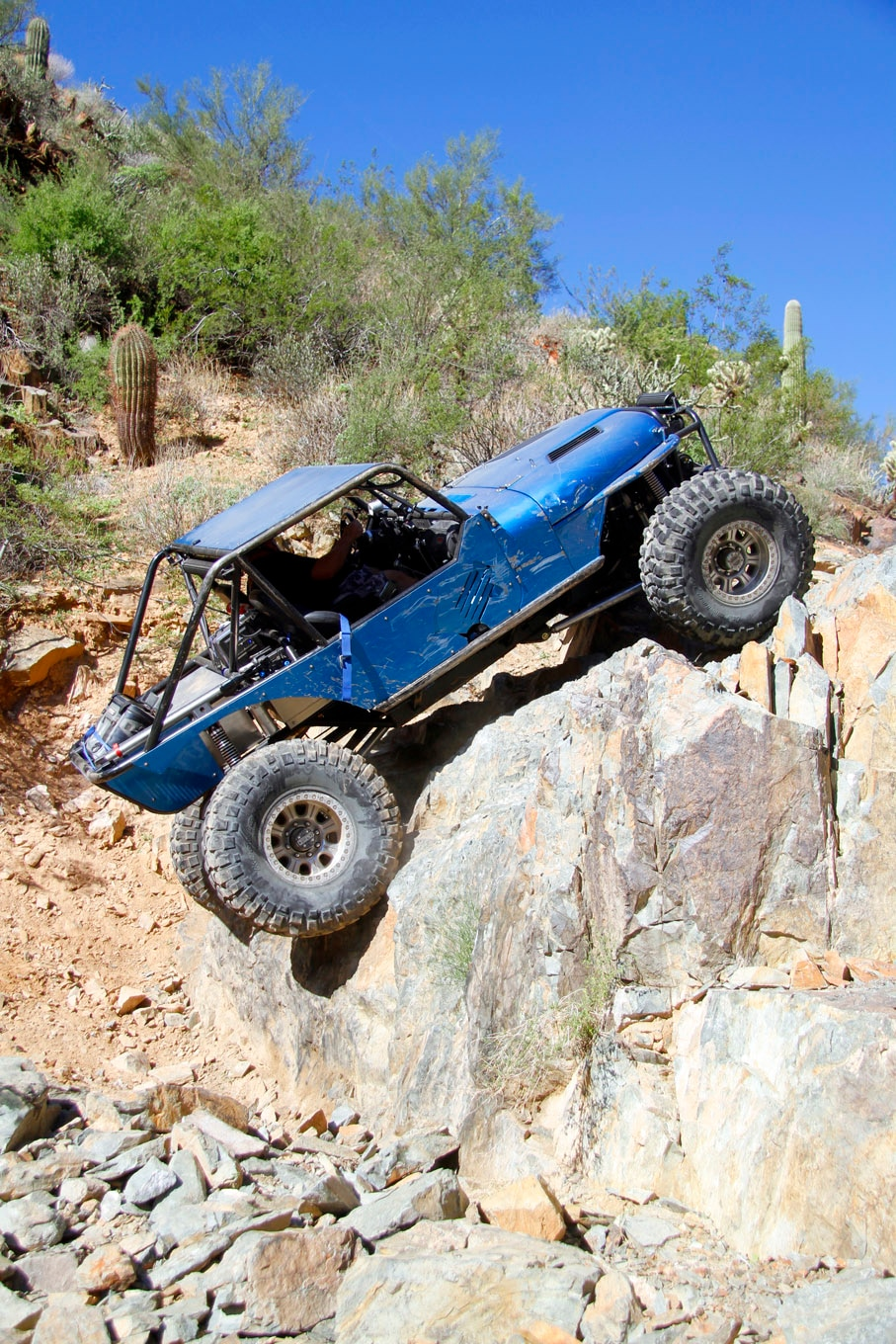 James Martinez takes the hard line on the biggest obstacle on Collateral Damage in his 1976 CJ-7. The Jeep has been tubed in the rear and linked with ORI struts. Rear steering on the GM Corporate 14-Bolt axle offers him an advantage on tricky obstacles.
