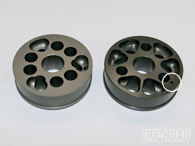 On the left is the top side of a 2.5 piston. The top side is the rebound side, and the rebound shim stack will sit against the six holes found close to the center. On the right is the bottom side of the same 2.5 piston. This is the compression side, and it faces downward. The compression shim stack sits against the three smaller round holes. You will also notice a tiny hole close to the outer edge. This hole is never covered by a shim, and is called a free bleed hole. Oil flows freely though this tiny hole, whose function is to smooth out the tiny bumps.
