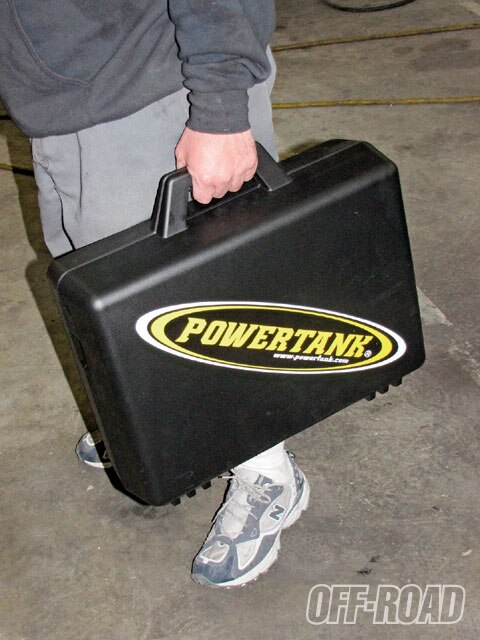 The entire Power Tank nitrogen shock charging system is held in this durable plastic suitcase. You can throw it in the back of your truck along with the rest of your equipment without fear of damaging your nitrogen filling kit.