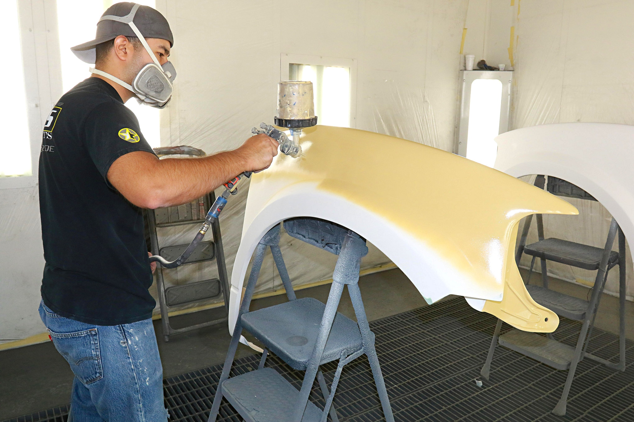 A primer/surfacer is used. This will fill in any problems and give the fenders a good thick coat to work with.
