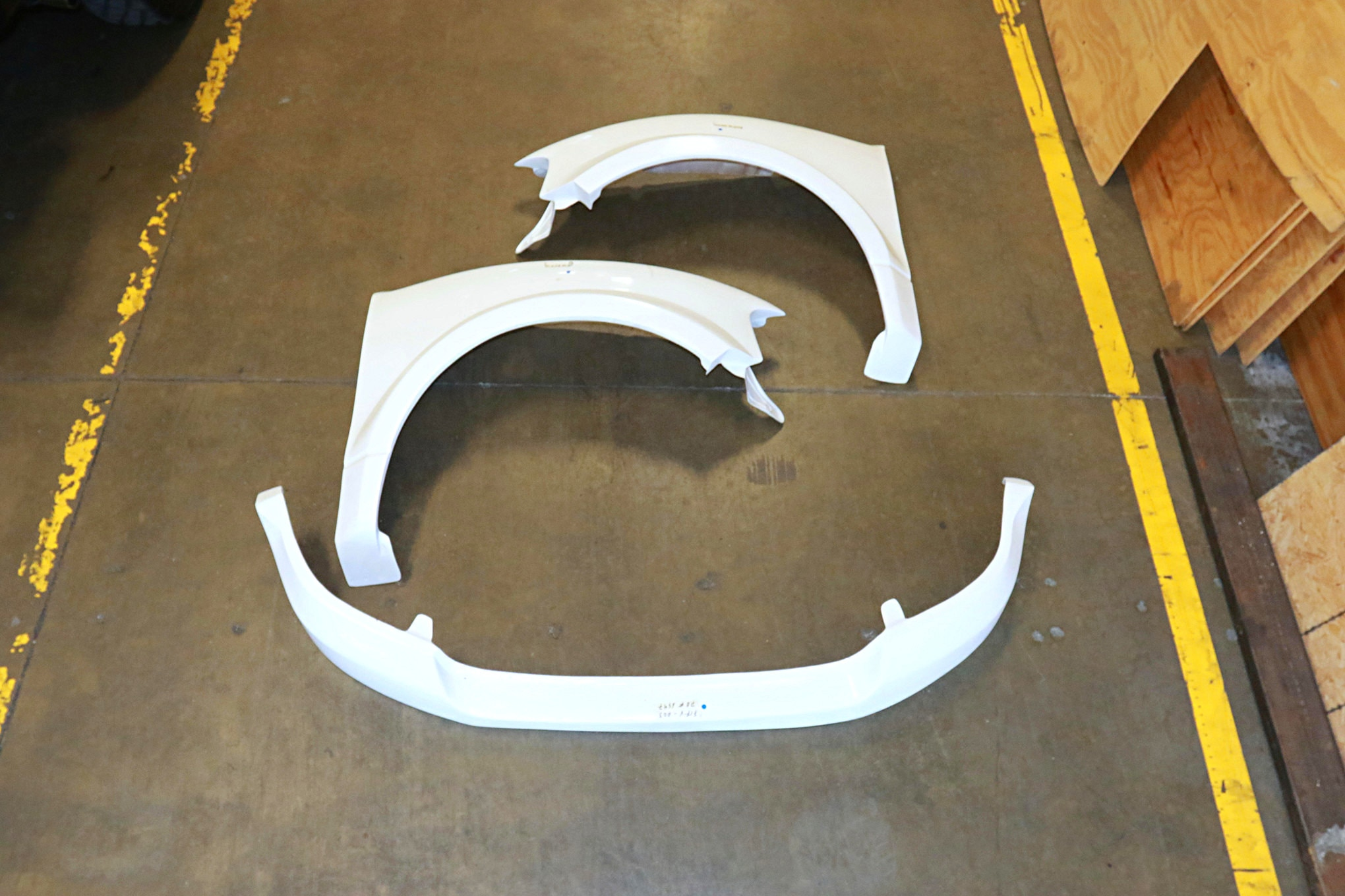 The Fiberwerx fiberglass fenders and lower valance are just one of many kits and pieces that Fiberwerx makes. Their workmanship is very good, and the parts fit well right out of the buck.