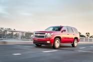 2015 Chevrolet Tahoe LT front three quarter in motion 02