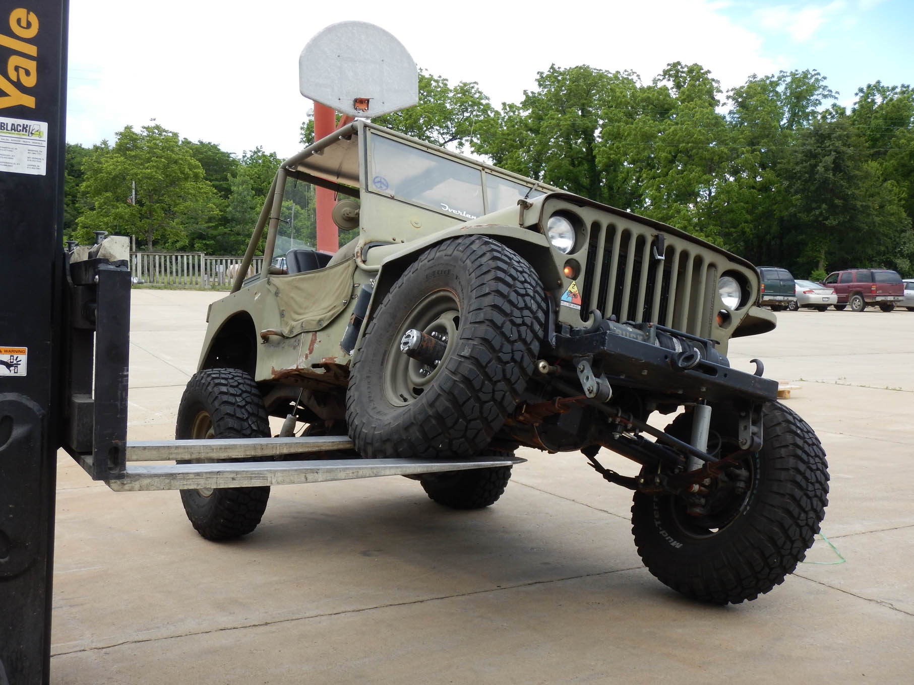 Daniel stopped to see a friend in Illinois, and just for grins, they put the CJ-2A on a forklift and flexed it a bit. The rear shocks were too short, but he already knew that. At a later date, he will need to make taller mounts for the rear shocks.