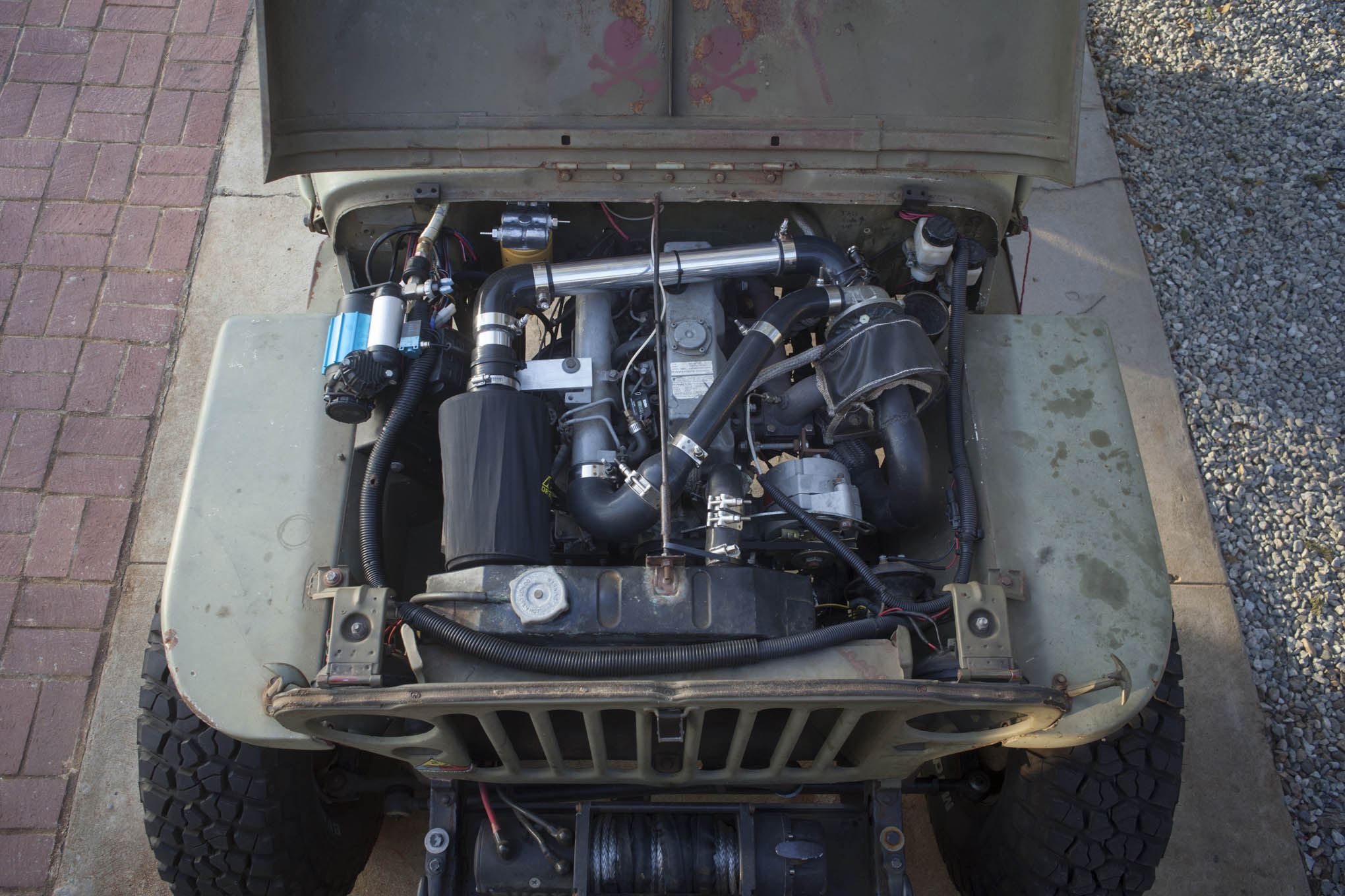 The Kubota 2.2L diesel was squeezed into the engine compartment, with the help of some motor mounts and a T-98 bellhousing adapter plate from Overland Diesel.