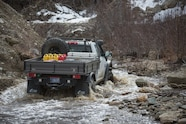 AEV Trucks Ice Road 20 ram in river
