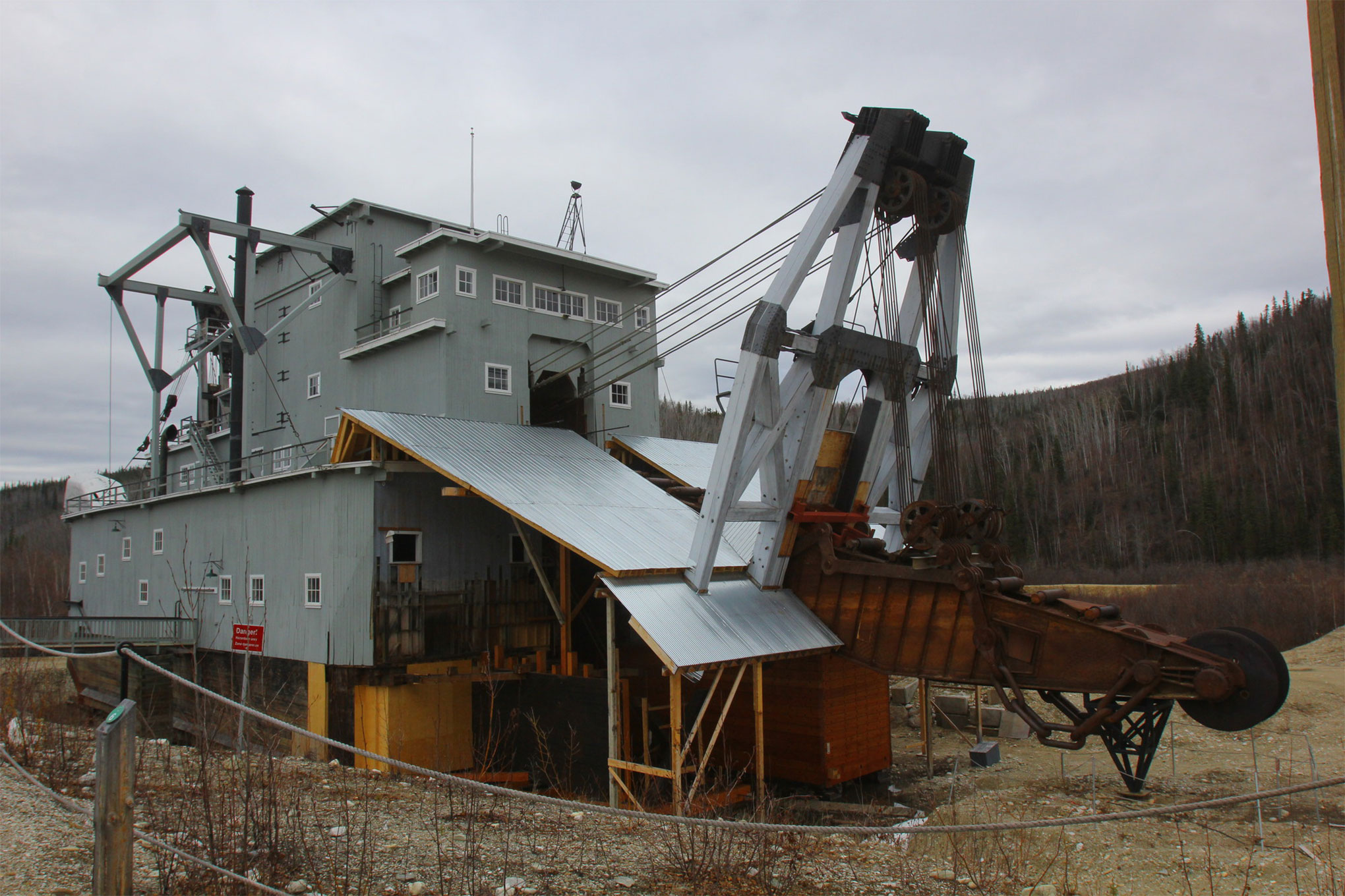 We headed out of Dawson and found an old mining dredge. The dredge was as big as a building but could float its way up small streams by digging a hole to fill with water. It floats itself and then mines all the soil around itself for gold.