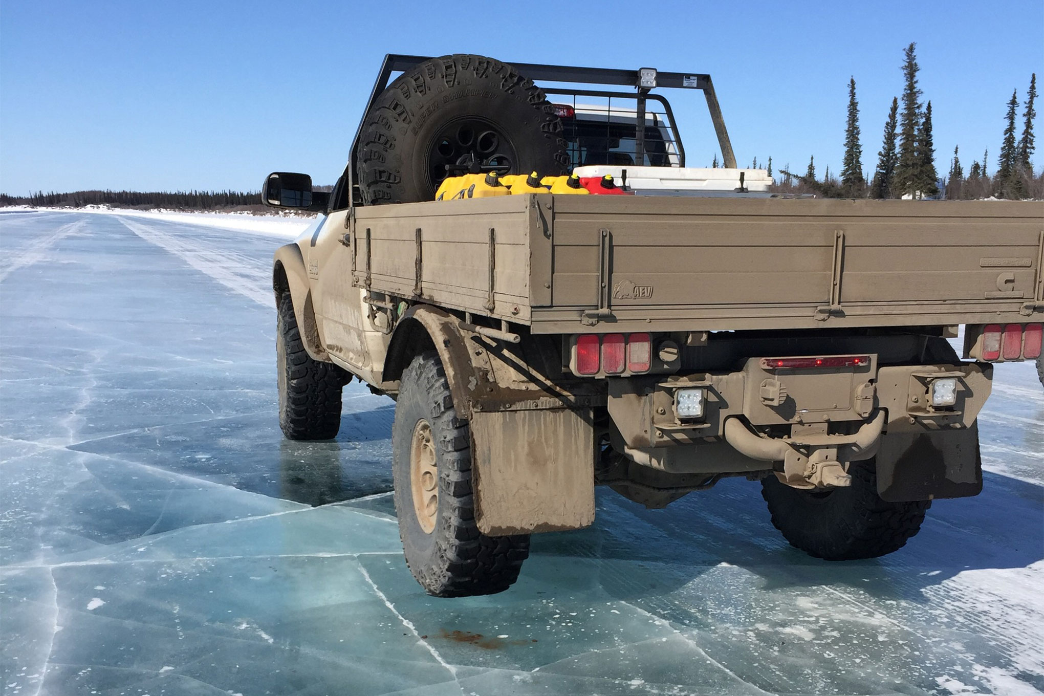 We drove all day and eventually the road changed from river to the Arctic Ocean. We were driving on frozen saltwater, and with ice over 8 feet thick it was plenty safe for our convoy.