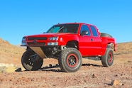 chevy red extrememotorsports mazzullaoffroad bfgoodrich method fox fiberwerx hannemann front three quarter low