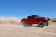 chevy red extrememotorsports mazzullaoffroad bfgoodrich method fox fiberwerx hannemann sliding front three quarter wide