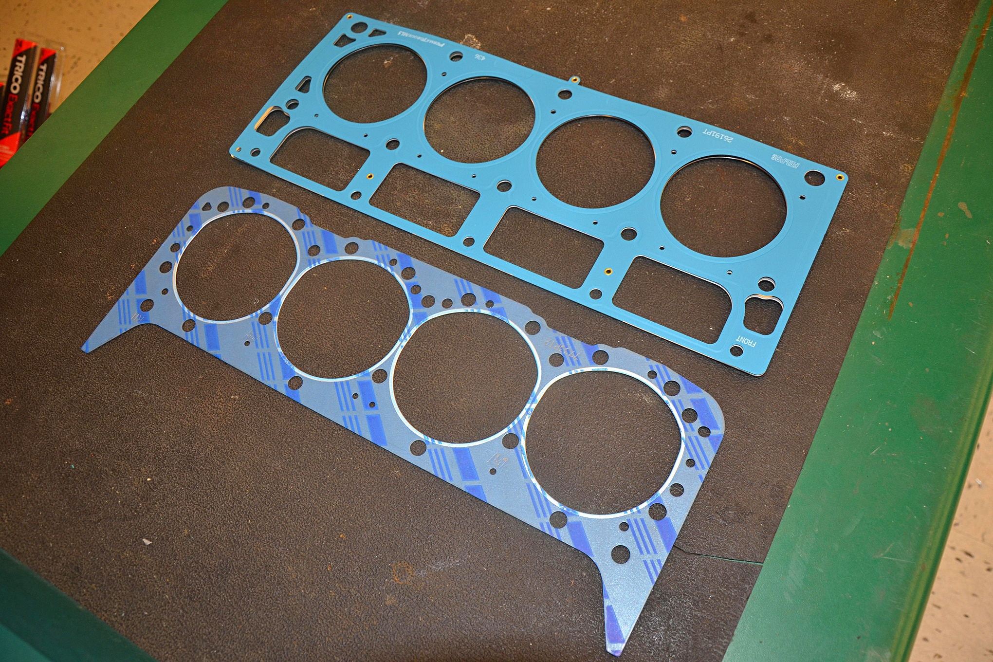 We also visited our local O'Reilly Auto Parts where we got a side-by-side look at a Fel-Pro PermaTorque MLS for a GM 5.3L LS (top) and a Fel-Pro PermaTorque composite gasket (bottom) for a GM Vortec 350 head. The MLS head gasket has become the standard for head sealing in many modern engines, but composites are still used as well. You can see the individual layers and rivets that hold everything together on the Felpro MLS and the blue silicon that Felpro uses to seal both gaskets. Cleanliness is next to godliness when it comes to proper head gasket installation.