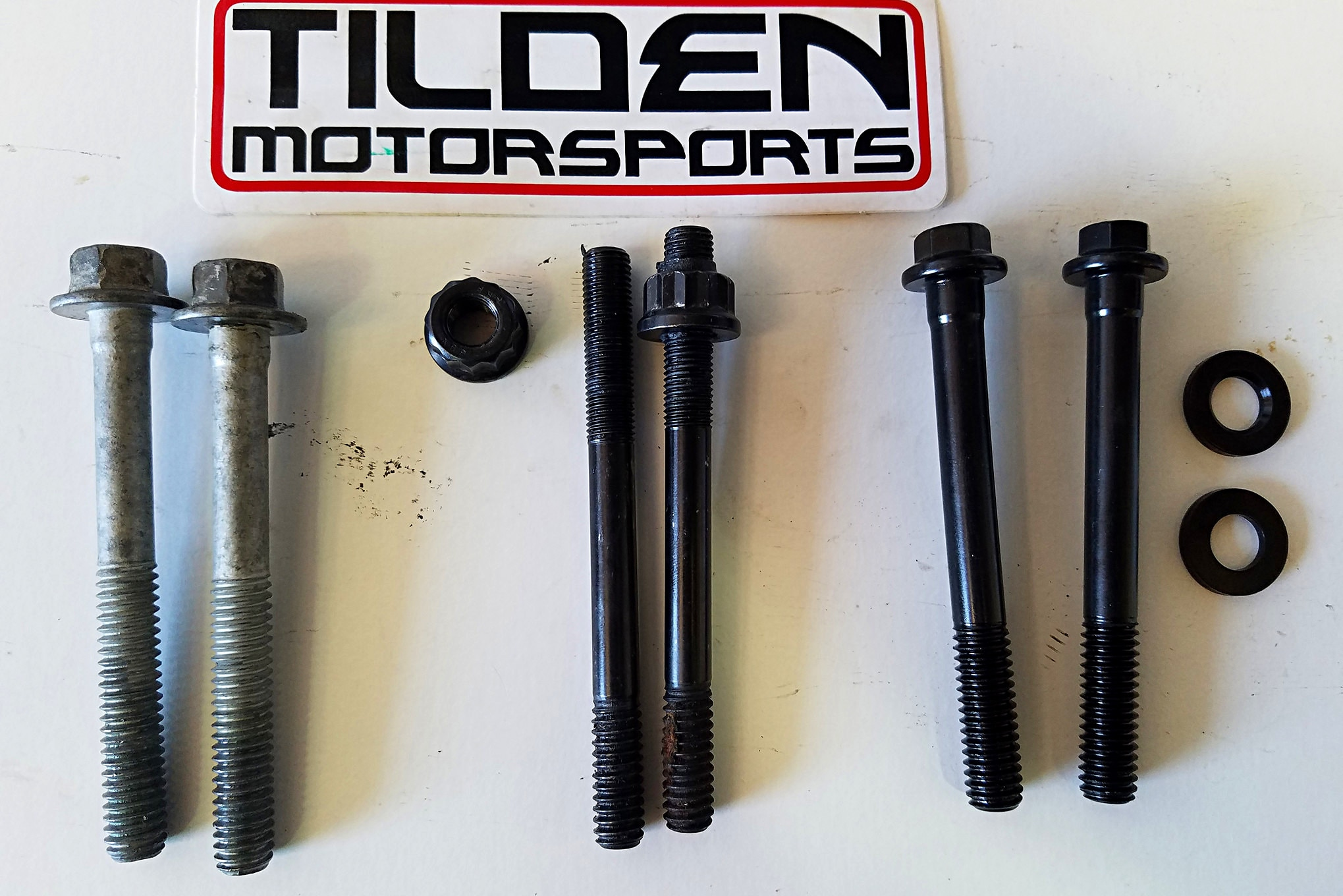 In another photo from Tilden Motorsports, from left to right we have ARP head bolts, stock LS head bolts, and ARP head bolts and nuts. Either the ARP head studs or ARP head bolts can be reused, but Tilden warns that the engine block has to be machined with the studs in place as they distort the bores. This is not necessary with the factory's TTY bolts or ARP's reusable head bolts since both distort the block in the same manner as each other.