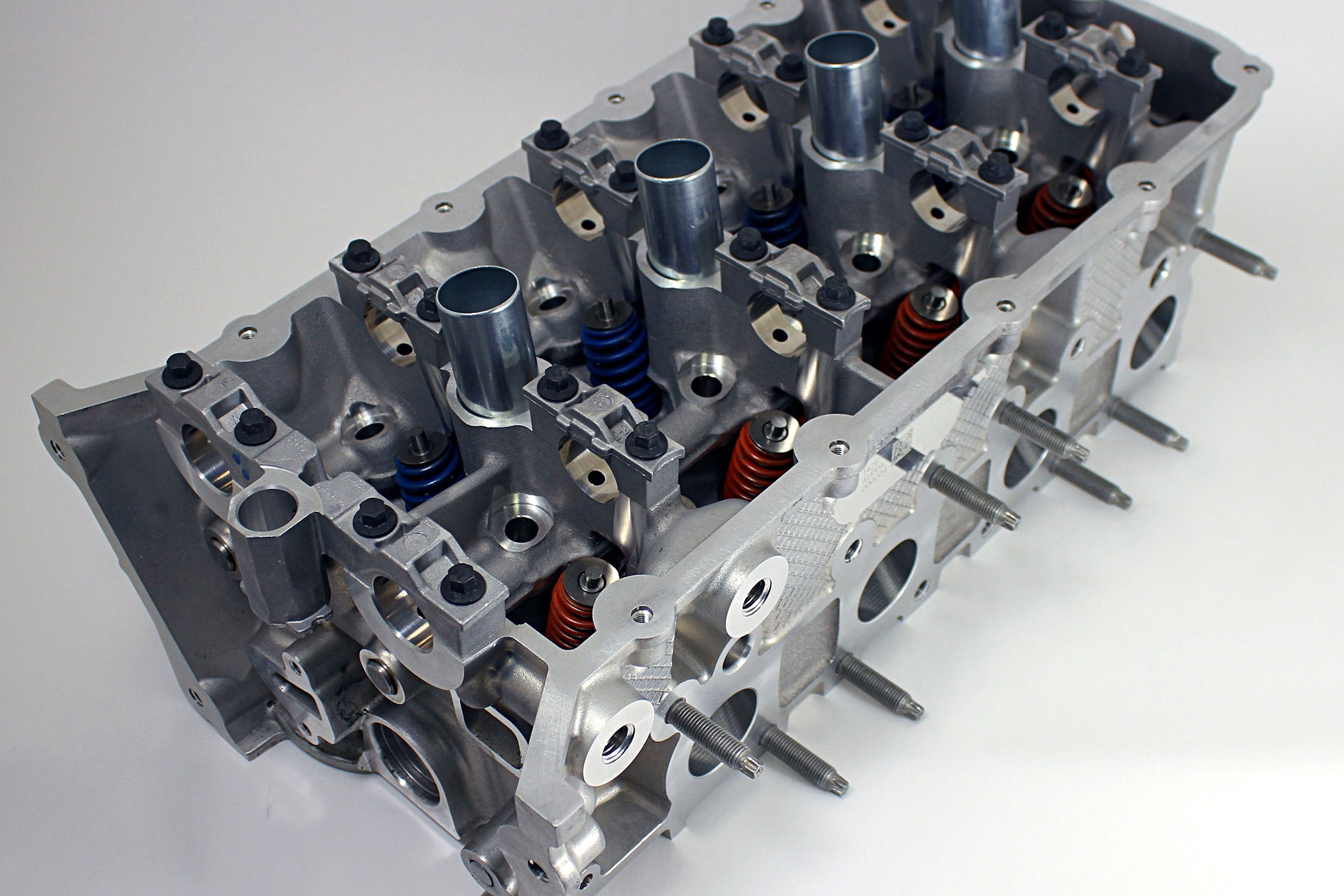 The 5.0L Coyote is the latest evolution of the Ford modular engine. With four valves per cylinder, dual overhead cams, cam-torque-actuated (CTA) Twin Independent Variable Cam Timing (we just barely know what some of that means) and more, this Coyote GT-350 head is quite complex relative to the GM flathead. Things have changed, and this head allows the Coyote to make quite a bit of power (more than 400 hp and about 400 lb-ft of torque) with a relatively small displacement while still burning 87-octane fuel.