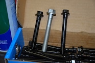 009 head tech One TTY head bolt with ARP head Bolts.JPG