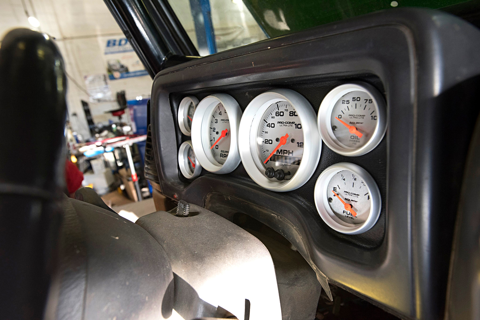 The dash in our old TJ was cracked and a couple gauges didn't work, so we dropped in a set of Auto Meter gauges in its Direct Fit Dash Panel. The gauges wired directly to the LS1 sensors so no special adapters were needed.