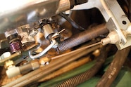 The throttle cable assembly was installed using the old return