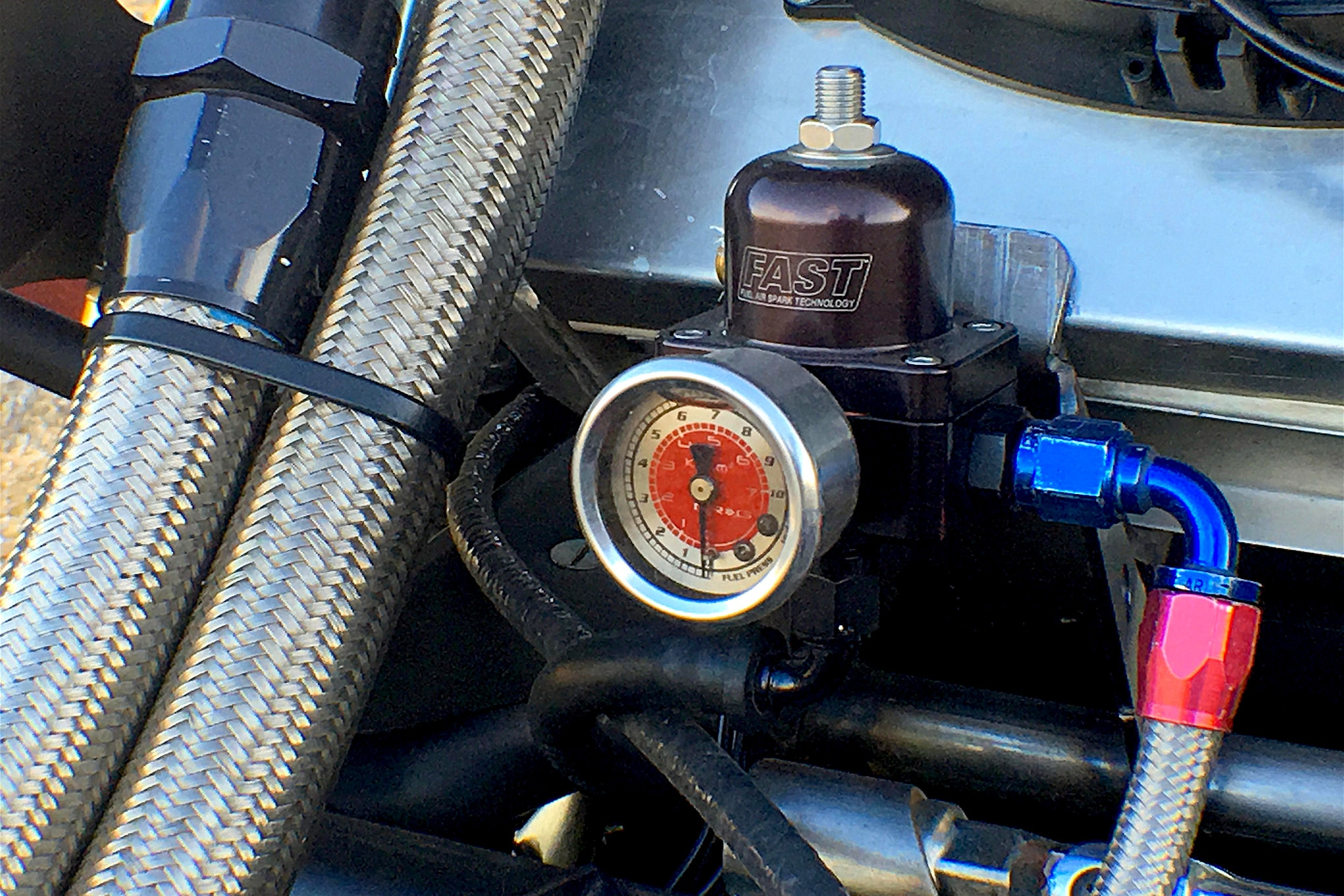 The FAST fuel system is plumbed with braided steel lines.