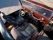 Under that swap meet steering wheel sits a Buick steering