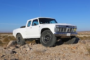 025 ford f100 bfgoodrich blitzkrieg fox eibach kmc dirt tech desertworks mcqueen trailer products front three quarter low.JPG