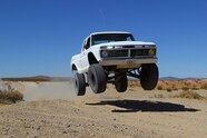 024 ford f100 bfgoodrich blitzkrieg fox eibach kmc dirt tech desertworks mcqueen trailer products jumping front three quarter.JPG