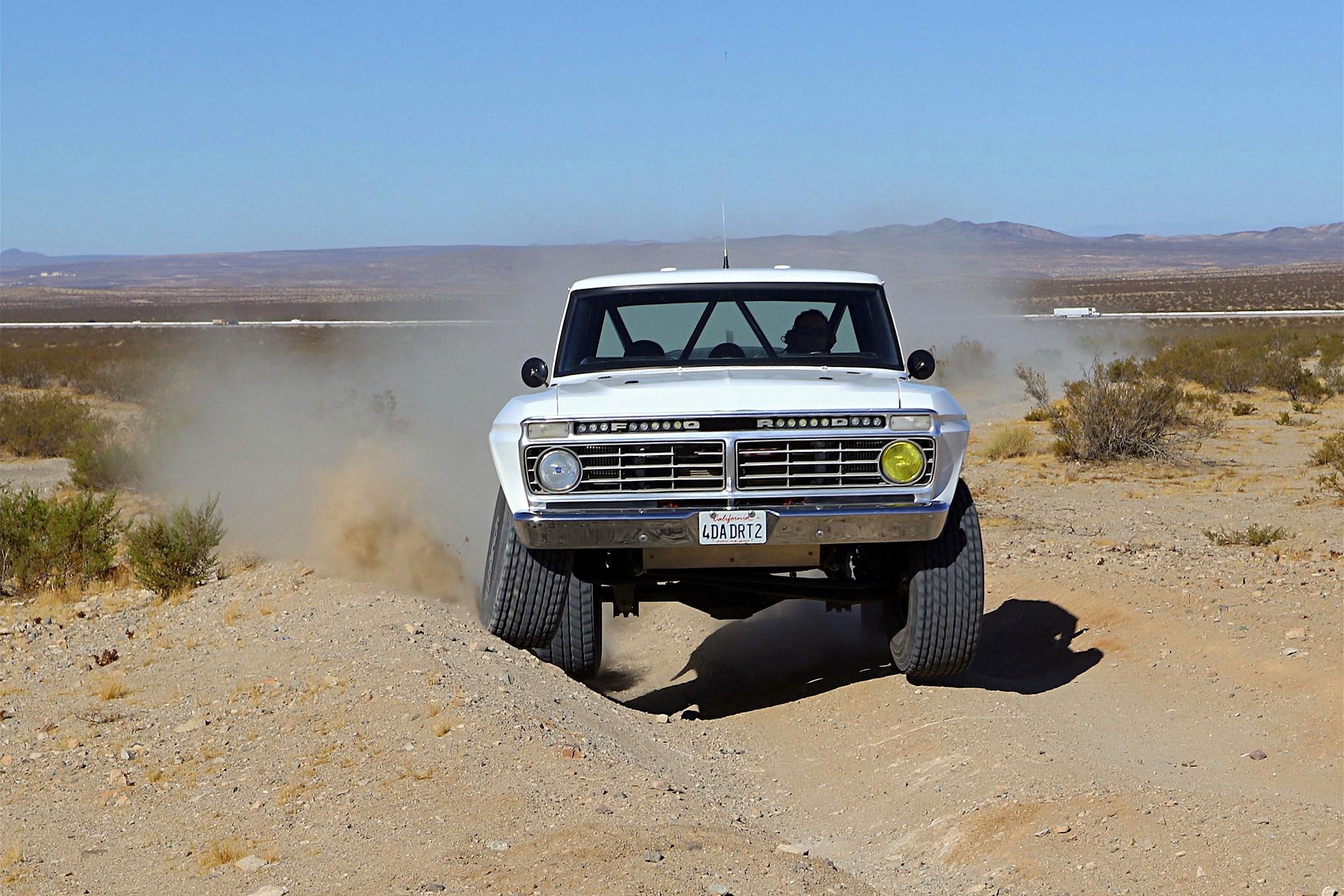 023 ford f100 bfgoodrich blitzkrieg fox eibach kmc dirt tech desertworks mcqueen trailer products driving head on.JPG