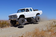 020 ford f100 bfgoodrich blitzkrieg fox eibach kmc dirt tech desertworks mcqueen trailer products jumping side.JPG