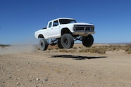 018 ford f100 bfgoodrich blitzkrieg fox eibach kmc dirt tech desertworks mcqueen trailer products jumping front three quarter.JPG
