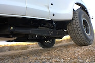 015 ford f100 bfgoodrich blitzkrieg fox eibach kmc dirt tech desertworks mcqueen trailer products trailing arm close up.JPG