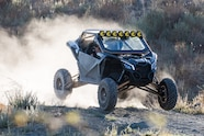 003 wolfpack motorsports can am x3 kchilites fuel offroad fox jumping front three quarter