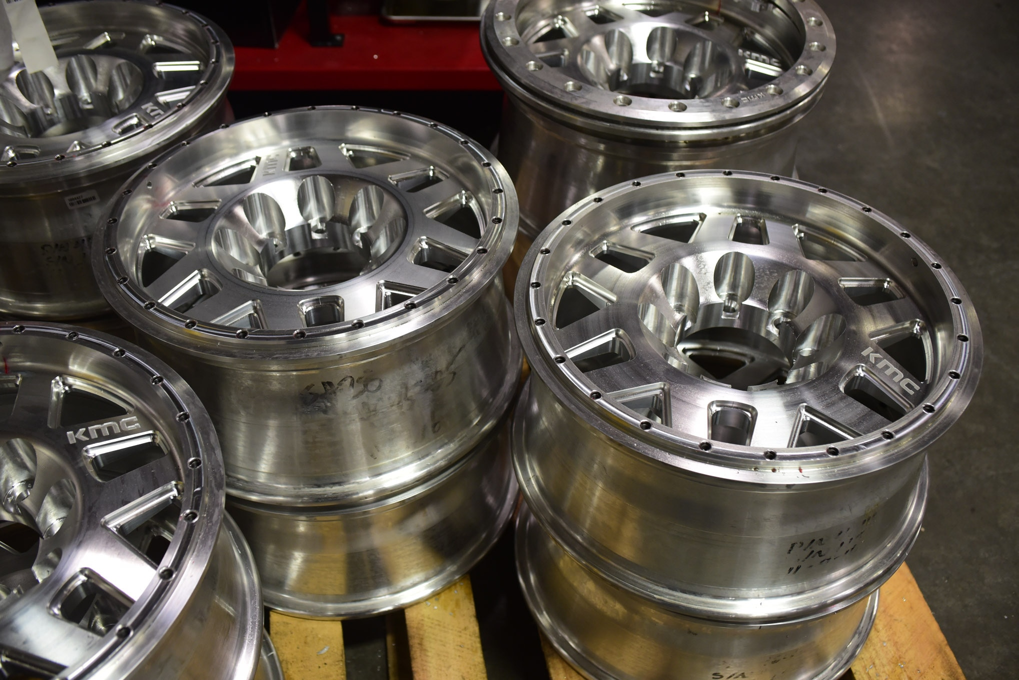A pallet full of finished forged aluminum monoblock wheels, milled and bored, are ready for final inspection prior to shipping out.