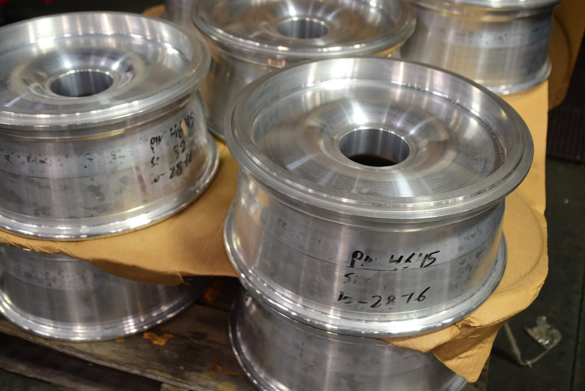 These monoblock aluminum wheels have reached the stage in the forging process at which they are ready for final milling and bolt and hub hole boring.