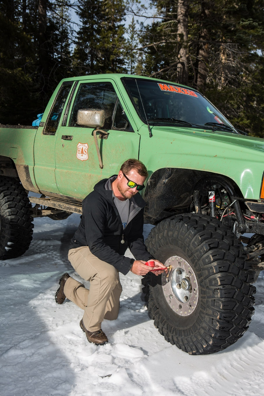 Airing down your tires to increase the contact patch is the best thing you can do increase your vehicle's prowess in deep snow. We typically run single-digit air pressure on tires that have a lot of sidewall and are mounted on beadlock wheels, like these 38-inch Maxxis Creepy Crawlers.